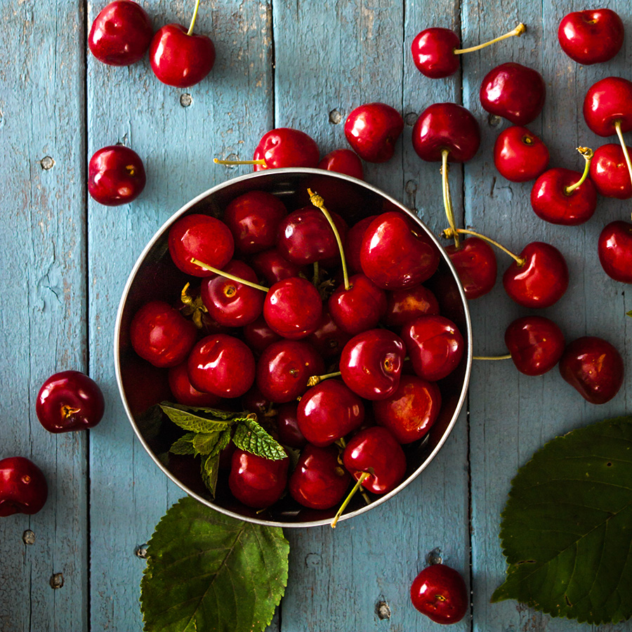 bowl of cherries on wood table