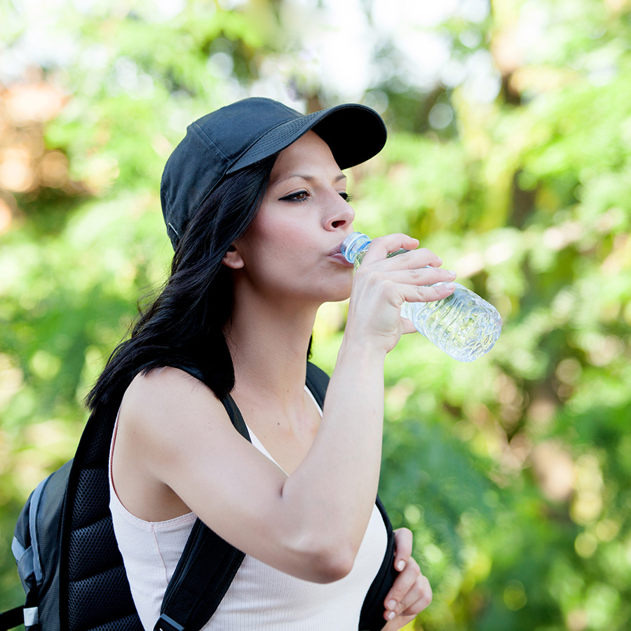 woman drinking water for healthy skin