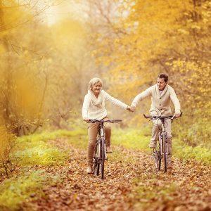 older couple riding bikes hormone balance BioTE