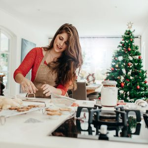 woman baking in kitchen during christmas